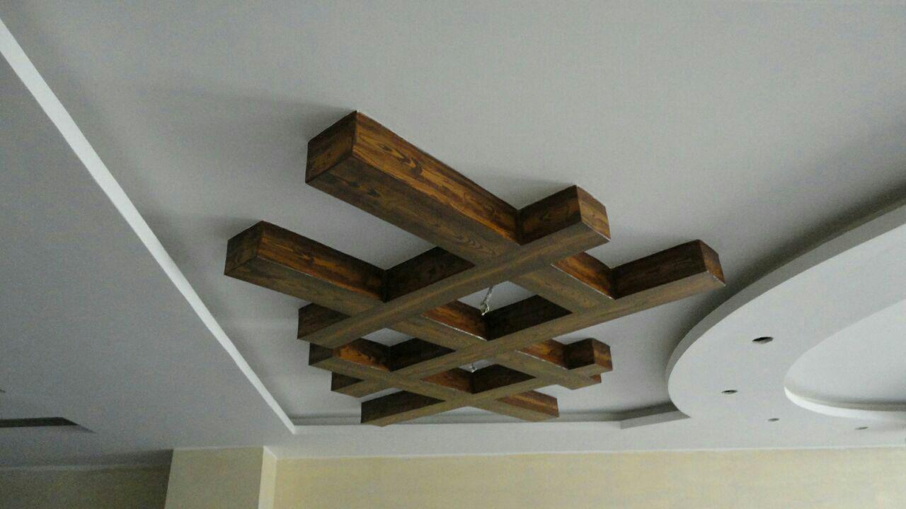 نمونه کار طرح چوب روی سقف دور لامپ